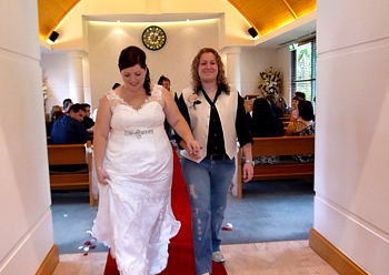 Donna & Bridget's recessional from the chapel after their Commitment Ceremony in at the Crowne Plaza in Surfers Paradise on the Gold Coast