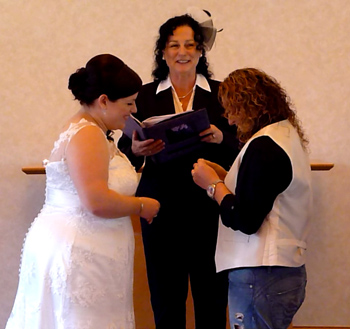 Donna & Bridget exchange rings at their Commitment Ceremony in the chapel at the Crowne Plaza in Surfers Paradise on the Gold Coast