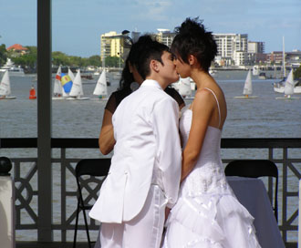 Same Sex Couple Holly and Sam kiss at their commitment ceremony in the beautiful gazebo at Newstead Park in fortitude Valley Brisbane
