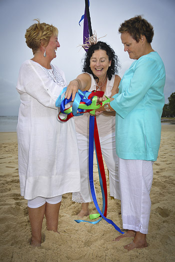 Rainbow Pride Celebrant Marilyn Verschuure conducted Jude & Barb's Handfasting Commitment on Bribie Island's legendary Pumicstone Passage Beach